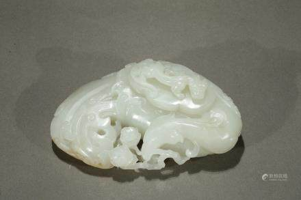 A white jade 'phoenix and chilong' washer