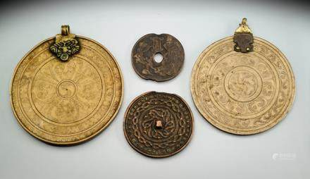 THREE BRONZE MAGIC MIRRORS AND AN AMULET, TIBET, 15th ct