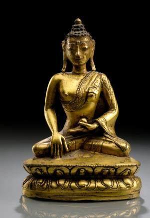 A GILT-BRONZE FIGURE OF BUDDHA SHAKYAMUNI, TIBET, 15th ct