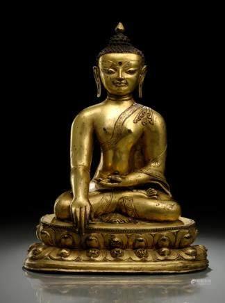 A LARGE GILT-BRONZE FIGURE OF BUDDHA SHAKYAMUNI, TIBET, late 15th ct