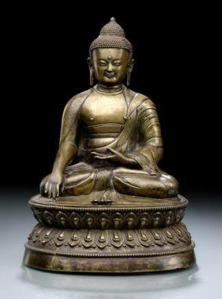 A BRONZE FIGURE OF BUDDHA SHAKYAMUNI (IN VAJRASANA), Tibet, 16th ct