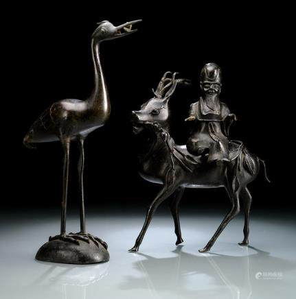 A BRONZE CENSER OF SHOULAO ON A DEER AND A BRONZE FIGURE OF A STANDING CRANE