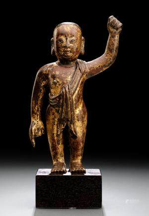 A BRONZE FIGURE OF STANDING INFANT BUDDHA