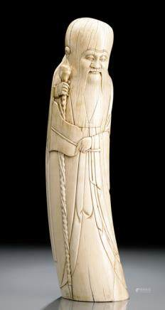 AN IVORY CARVING OF STANDING SHOULAO HOLDING A STAFF