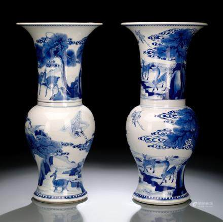 A NEAR PAIR OF UNDERGLAZE BLUE YENYEN VASES WITH CRANES AND DEER