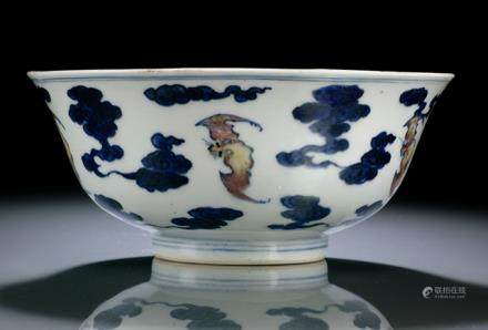 A RARE COPPER-RED AND BLUE AND WHITE BATS AND CLOUD BOWL
