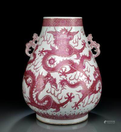 A FINE PUCE-DECORATED FIVE DRAGON PORCELAIN HU-SHAPED VASE