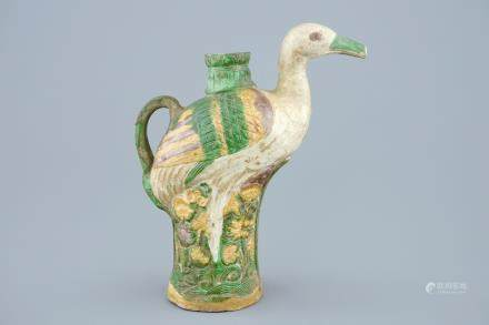 A Chinese verte biscuit crane-shaped ewer, 18/19th C.