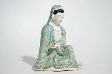 A Chinese famille rose model of a seated Guanyin, 19th C.
