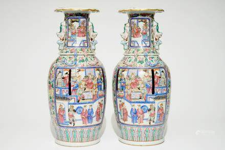 A pair of Chinese famille rose vases with court scenes, 19th C.