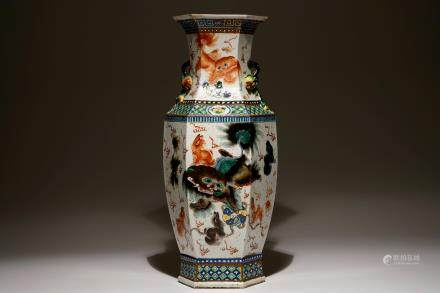 A Chinese hexagonal famille verte vase with buddhist lions, 19th C.