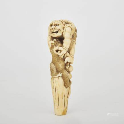 "A Carved Ivory Oni and Monkey Cane Handle, Meiji Period, height 4.8"" — 12.1 cm."