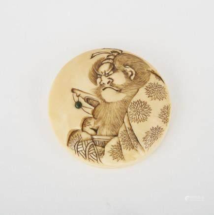 "A Carved Ivory Manju Netsuke, Meiji Period, diameter 2"" — 5.1 cm."
