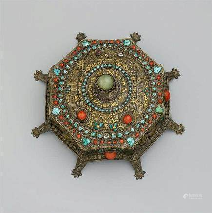 A Nepalese octagonal parcel gilt silver box