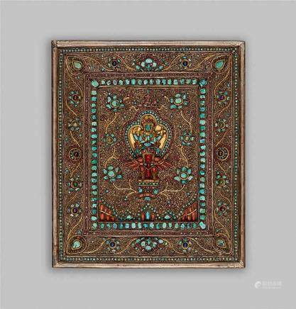 A Nepalese parcel gilt silver panel inset with semi-precious stones