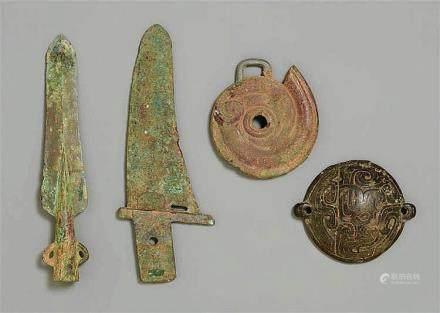 Four archaic bronze objects. Western Zhou dynasty, around 10th/9th century B.C.