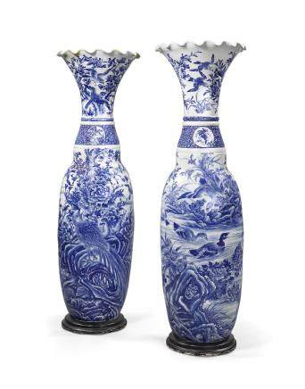 A PAIR OF MASSIVE BLUE-AND-WHITE OVOID PORCELAIN URNS