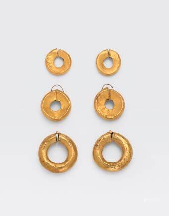 THREE PAIRS OF GOLD SLIT-HOOP EARRINGS
