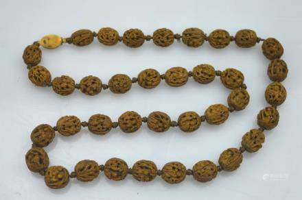 19th C; 37 Finely Carved Chinese Nut Bead Necklace