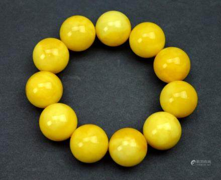 47.5 Grams of Yellow Amber in 11 Round Beads