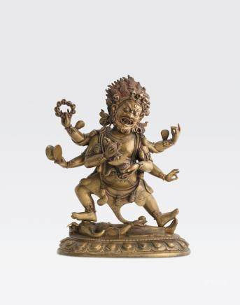 A GILT COPPER ALLOY FIGURE OF SHADBHUJA MAHAKALA Qing dynasty, 18th/19th century