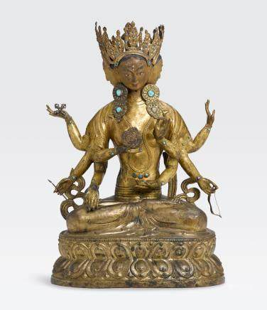A LARGE GILT COPPER ALLOY REPOUSSÉ FIGURE OF USHNISHAVIJAYA Qing dynasty, 18th century