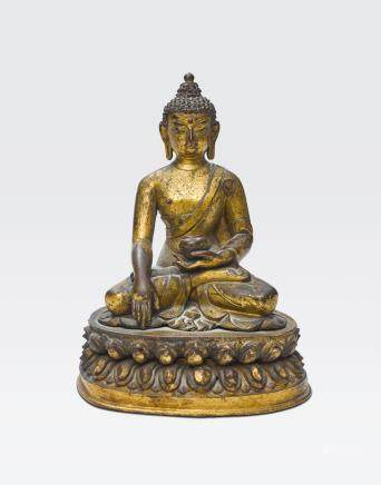 A GILT COPPER ALLOY FIGURE OF BUDDHA Nepal, 16th/17th century
