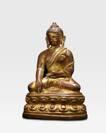 A GILT COPPER ALLOY FIGURE OF BUDDHA Nepal, 14th century