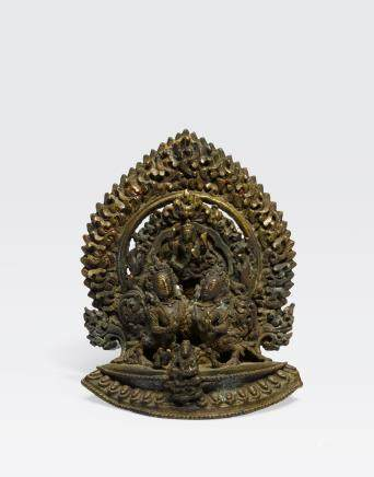 A CAST COPPER ALLOY FIGURAL GROUP Nepal, 19th century or earlier