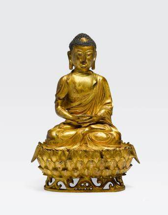 A GILT BRONZE SEATED BUDDHA AND LOTUS STAND Ming dynasty, 16th/17th century
