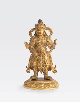 A SMALL GILT BRONZE GUARDIAN DEITY Qing dynasty, 18th/19th century