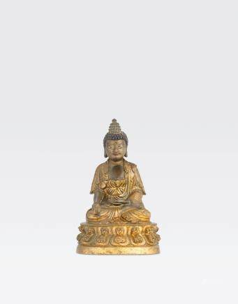 A GILT COPPER ALLOY FIGURE OF THE MEDICINE BUDDHA Qing dynasty, 18th/19th century