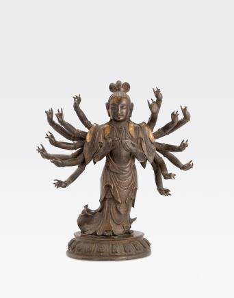 A CAST-BRONZE FIGURE OF DOUMU Qing dynasty