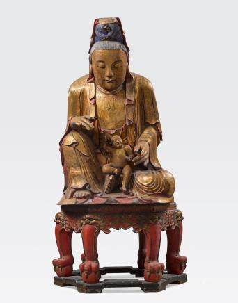 A MASSIVE POLYCHROME AND GILT LACQUERED WOOD FIGURE OF GUANYIN, THE GIVER OF SONS, SONGZI GUANYIN Late Qing dynasty