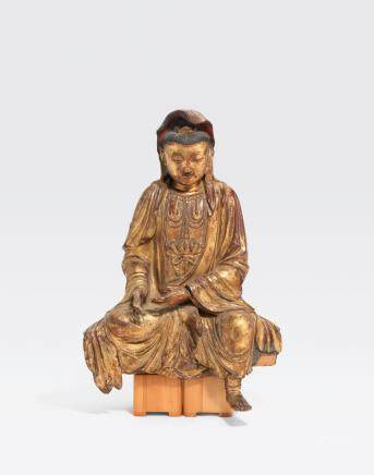 A LARGE GILT LACQUERED WOOD FIGURE OF A SEATED BODHISATTVA Qing dynasty