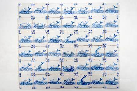 A set of 47 Dutch Delft blue and white seacreature tiles, Pulinckx workshop, Bruges, 18th C.