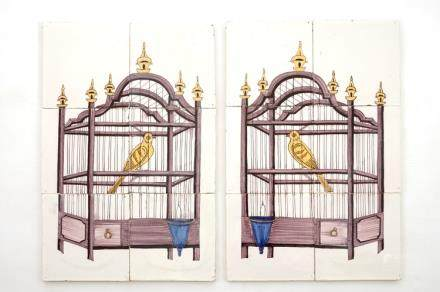 A pair of polychrome Dutch Delft tile panels with canaries in a cage, 18/19th C.