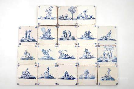A set of 18 Dutch Delft blue and white biblical tiles, 17/18th C.
