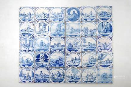 A set of 30 Dutch Delft blue and white biblical tiles, Utrecht, 19th C.