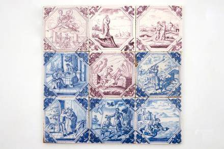 A set of nine Dutch Delft blue and white and manganese tiles, 18th C.
