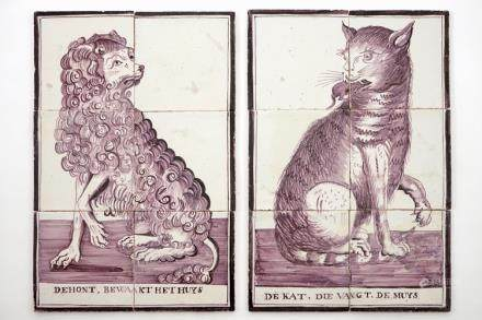 A pair of manganese Dutch Delft tile panels with a cat and a dog, late 18th C.