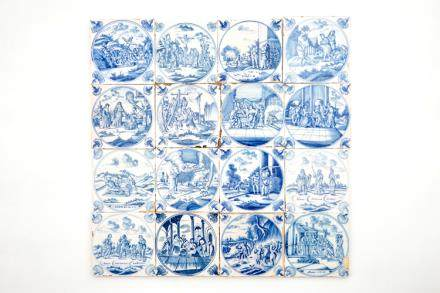 A set of 16 Dutch Delft blue and white biblical tiles with carnation corners, 18th C.