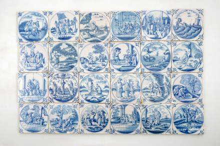 A set of 24 Dutch Delft blue and white biblical tiles, 18th C.