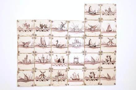 A set of 26 manganese Dutch Delft landscape tiles, 18/19th C.