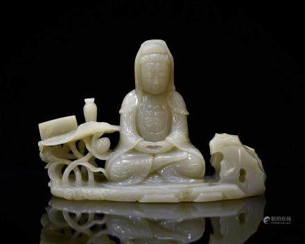 CARVED JADE SEATED GUANYIN