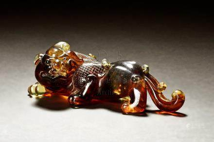 AMBER CARVED 'MYTHICAL BEAST' FIGURE