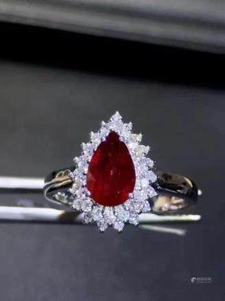 A NATURAL DROP-SHAPED PIGEON-BLOOD RUBY RING