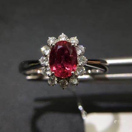 A NATURAL OVAL-SHAPED RUBY RING