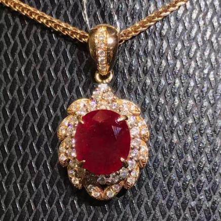 A NATURAL EGG-SHAPED PIGEON-BLOOD RUBY PENDANT