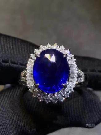 A NATURAL EGG-SHAPED SAPPHIRE RING